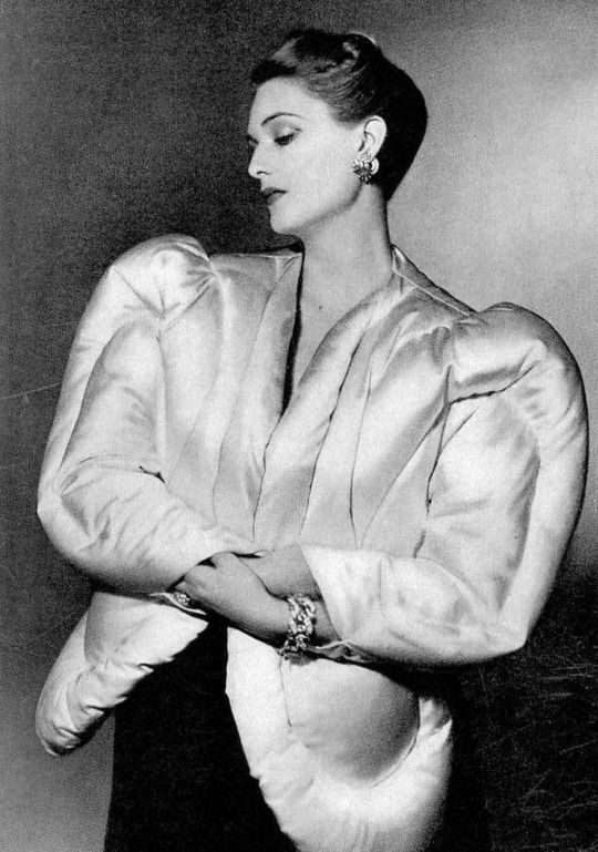 Sculptural white satin evening jacket padded with eiderdown and quilted in round arabesque patterns by Charles James _ Photo by Horst, Harper's Bazaar, 1938.