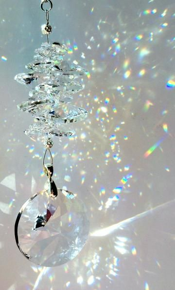 Image result for crystal suncatchers throwing rainbows on a wall""