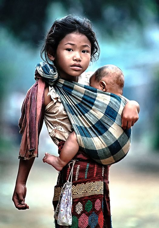 A Girl Taking Care Of A Baby In Luang Prabang Laos For The Best