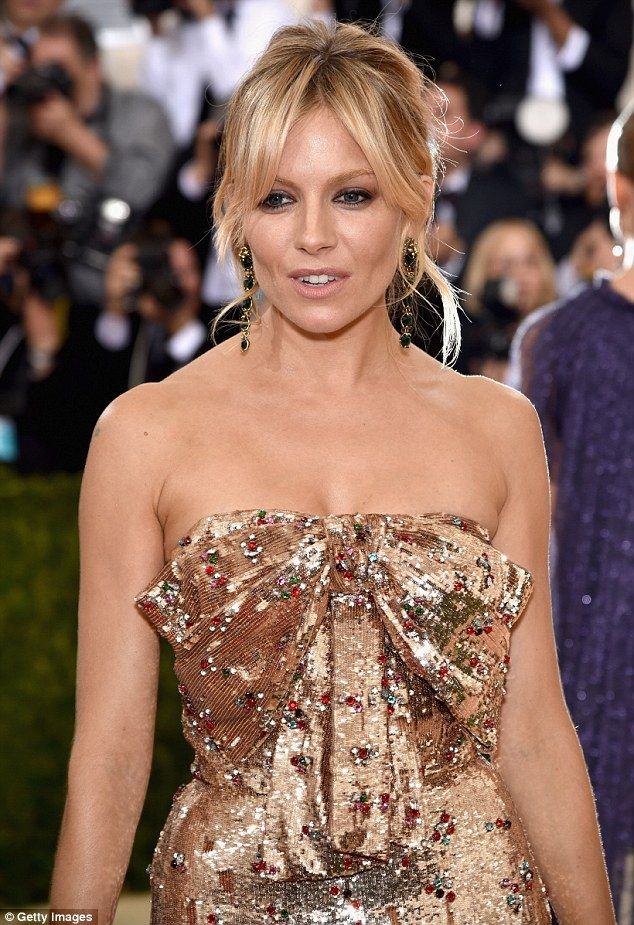 Sienna Miller flaunts her toned frame and revealing decolletage in a glittering strapless gown at the Met Gala in New York | Daily Mail Online
