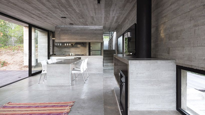 This house is made almost entirely from concrete. The vanities, the counters, the furniture - it's all so sleek and modern. So clean looking. The