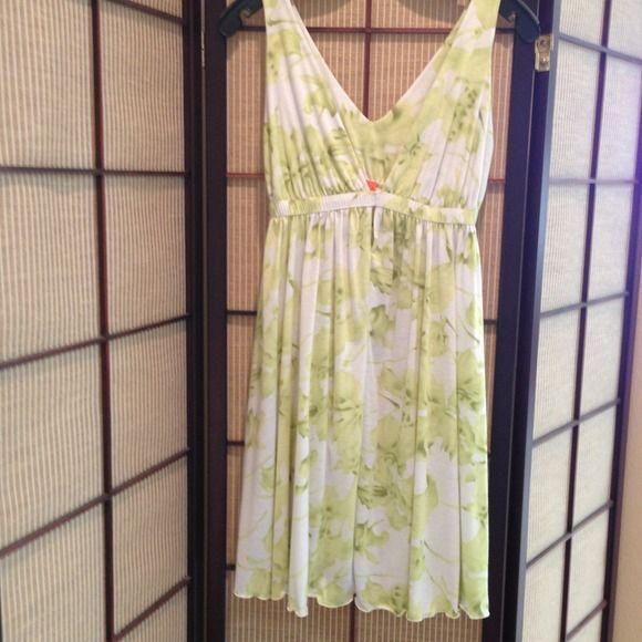Pretty summer dress! Brand new, never worn. Summer, cotton, floral dress with a deep v front neckline. Dresses