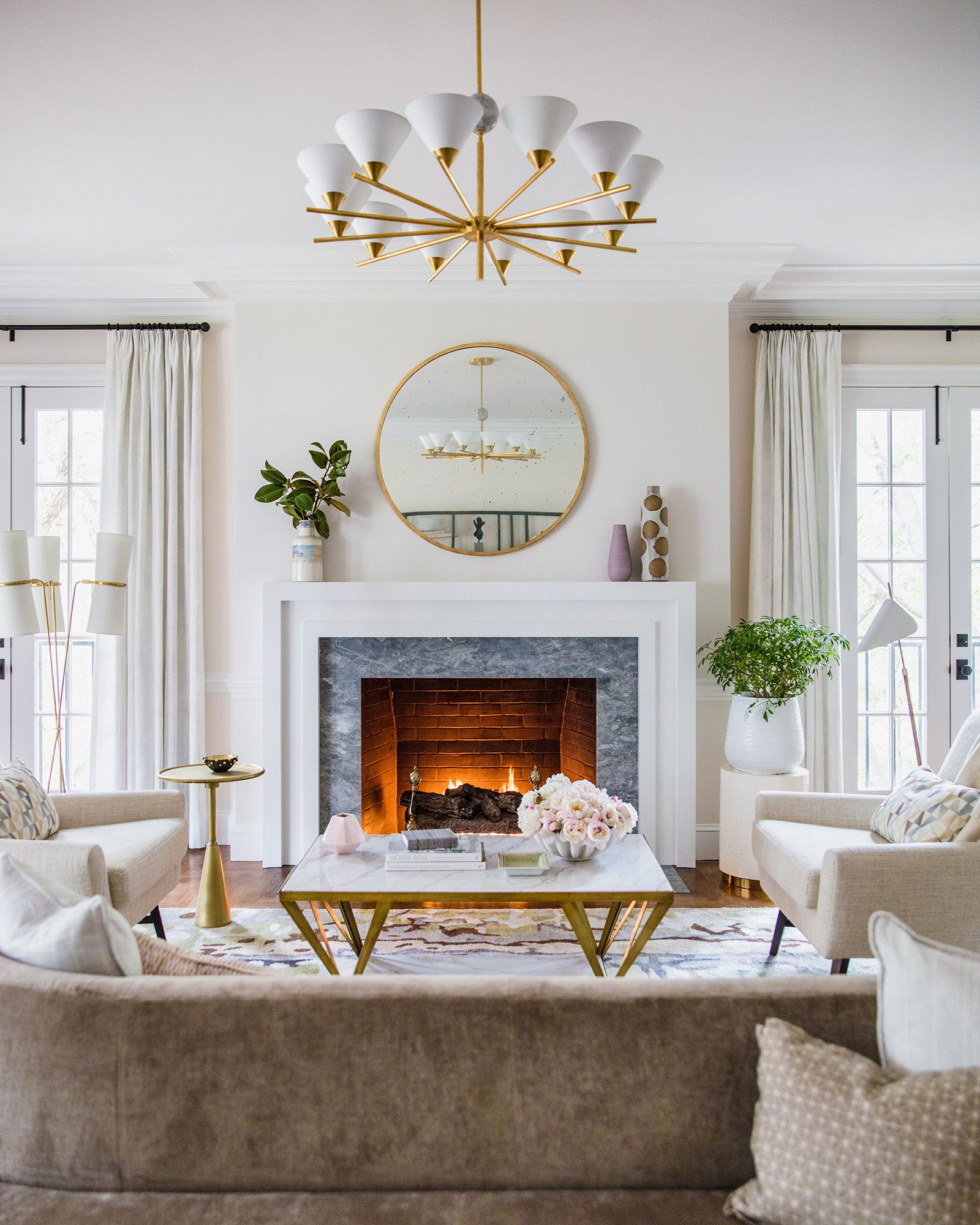White Transitional Fireplace Design With Gray Marble Surround Tile Round Mirror Over The Living Room With Fireplace Fireplace Design Transitional Fireplaces