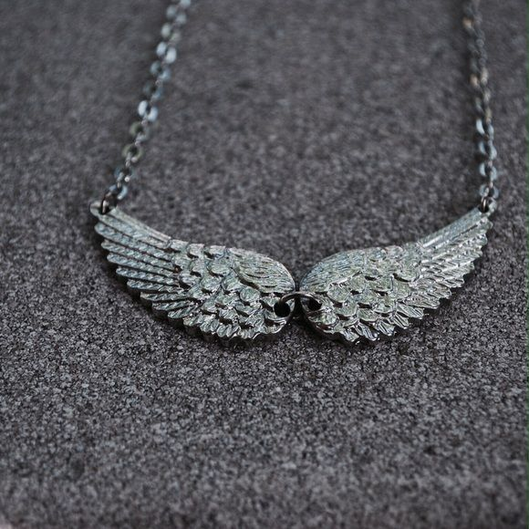 Angel Wings Necklace Silver tone angel wings necklace. Adjustable length. Never been worn. Jewelry Necklaces