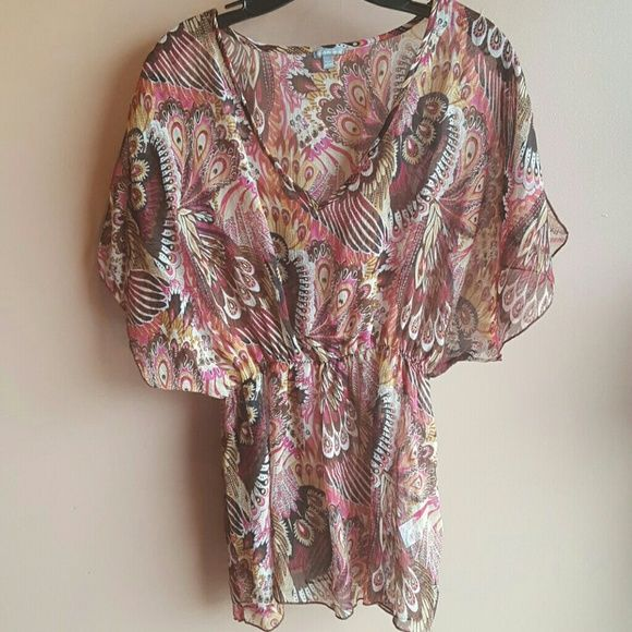 Paisley print top I've had this one for a couple years and is that sheer material. It has a stretchy band right under the boobs area. No holes or rips either ;) Charlotte Russe Tops Blouses