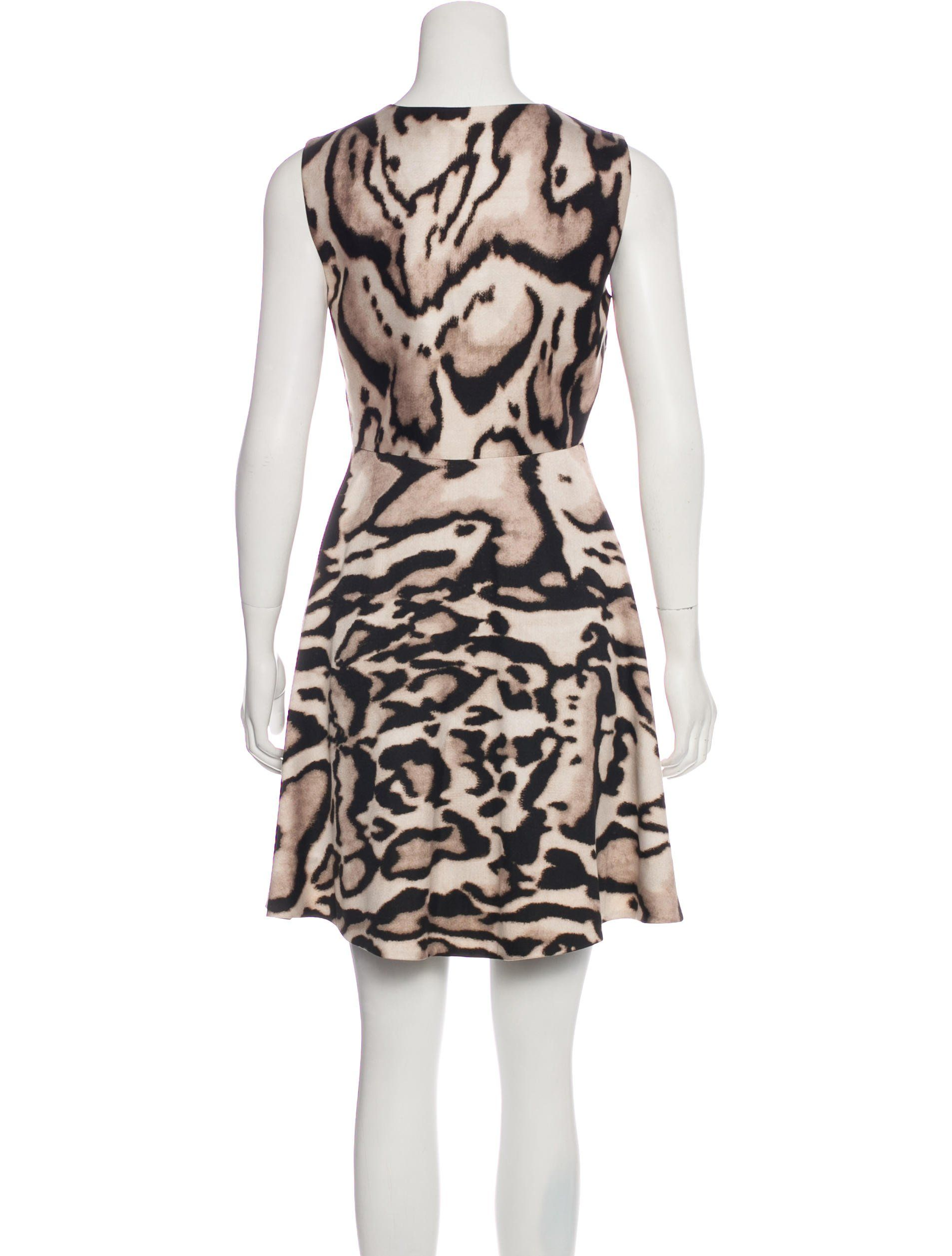 cfb9d5d5dcba Beige and black Diane von Furstenberg Renna sleeveless mini dress with animal  print throughout, V-neck and concealed zip closure at side.