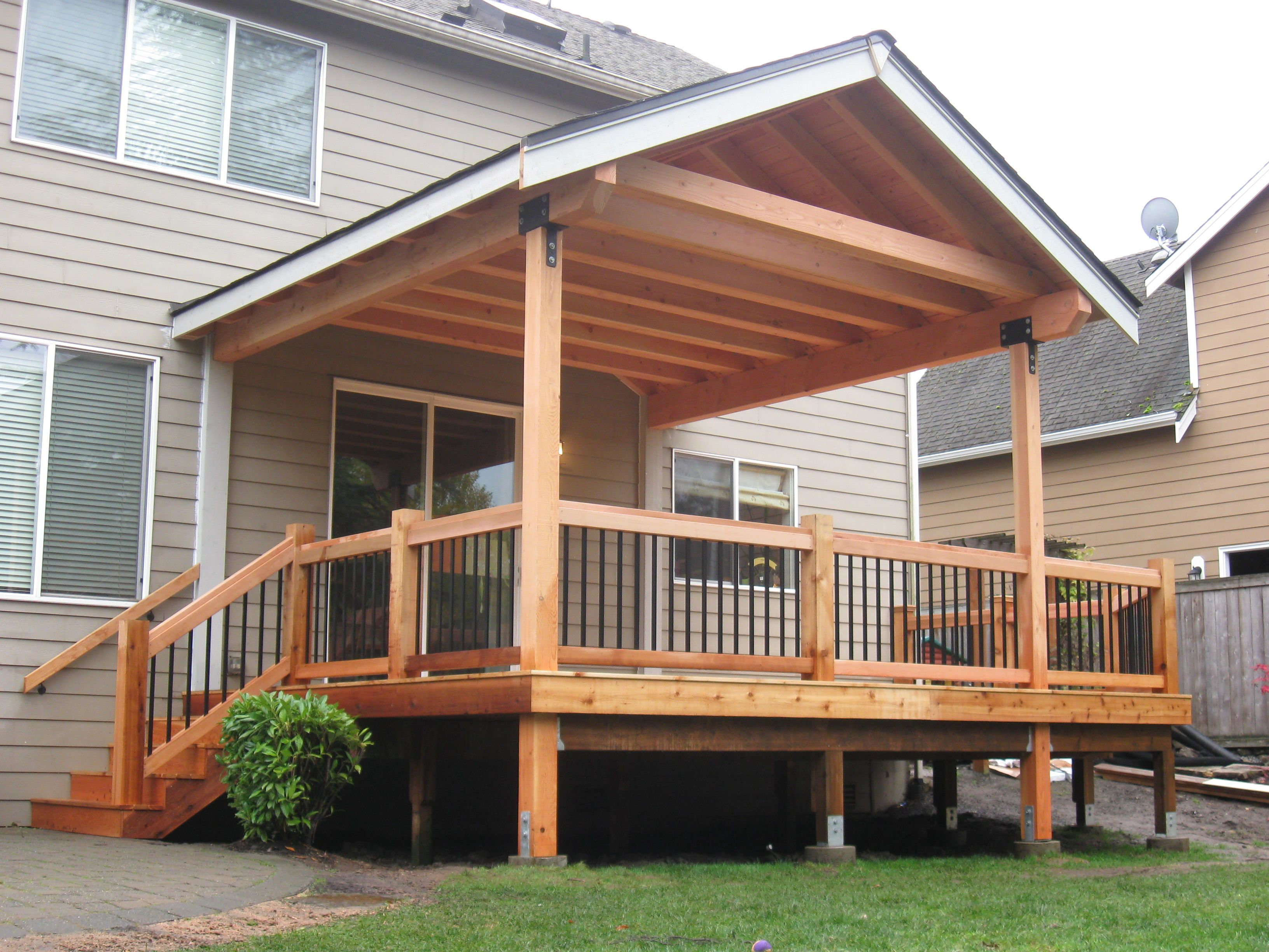 Fir timber framed roof cover over cedar deck built by for Deck roof plans
