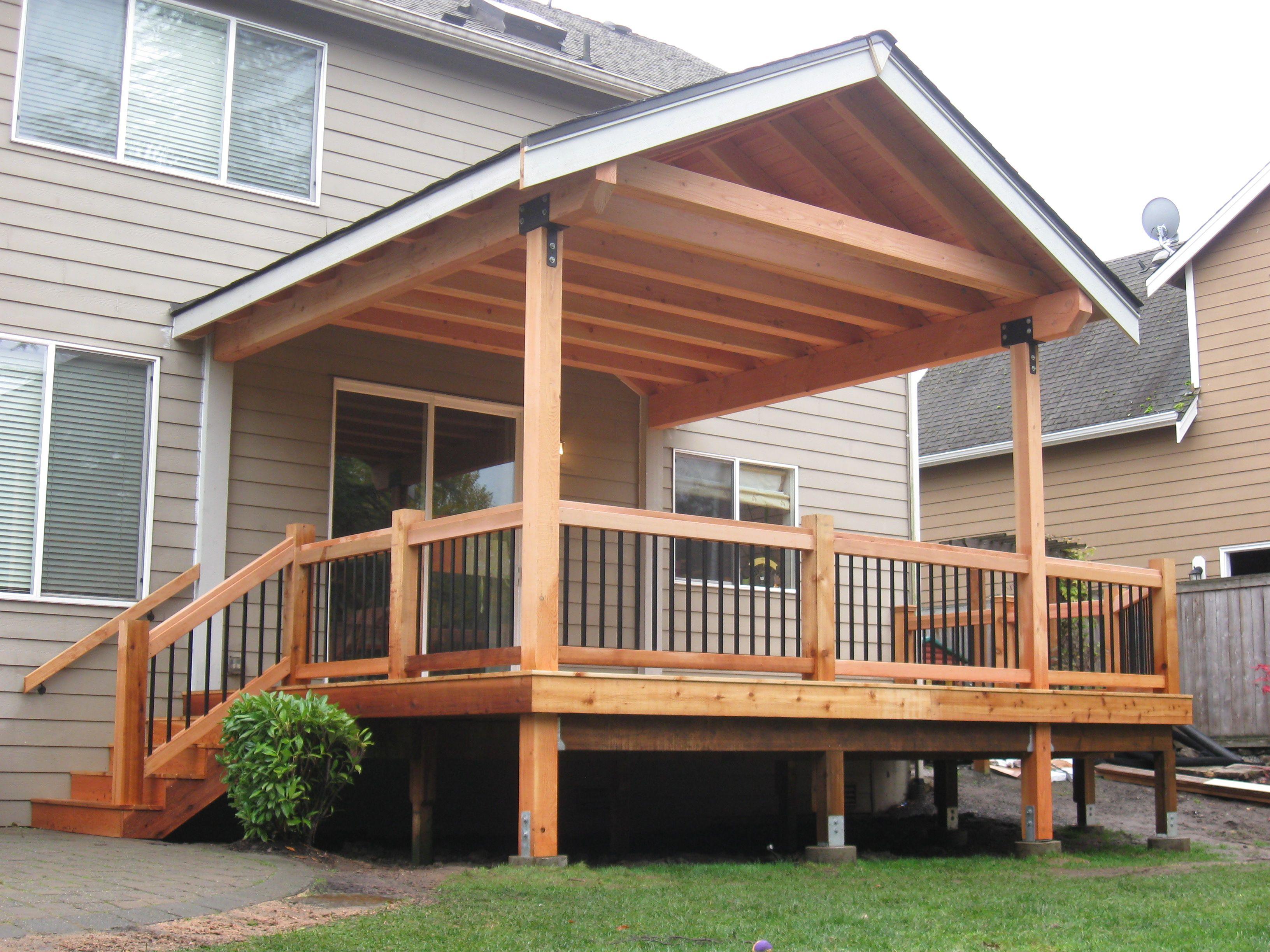 Fir timber framed roof cover over cedar deck built by
