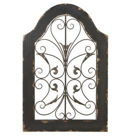 """Featuring an arched frame and scrolling metalwork details, this window-inspired wall decor adds an artful touch to any room.   Product: Wall decorConstruction Material: Wood and metalColor: Brown and blackFeatures: Scrolling detailsWindow-inspiredDimensions: 36.25"""" H x 24.5"""" W x 1.25"""" D"""
