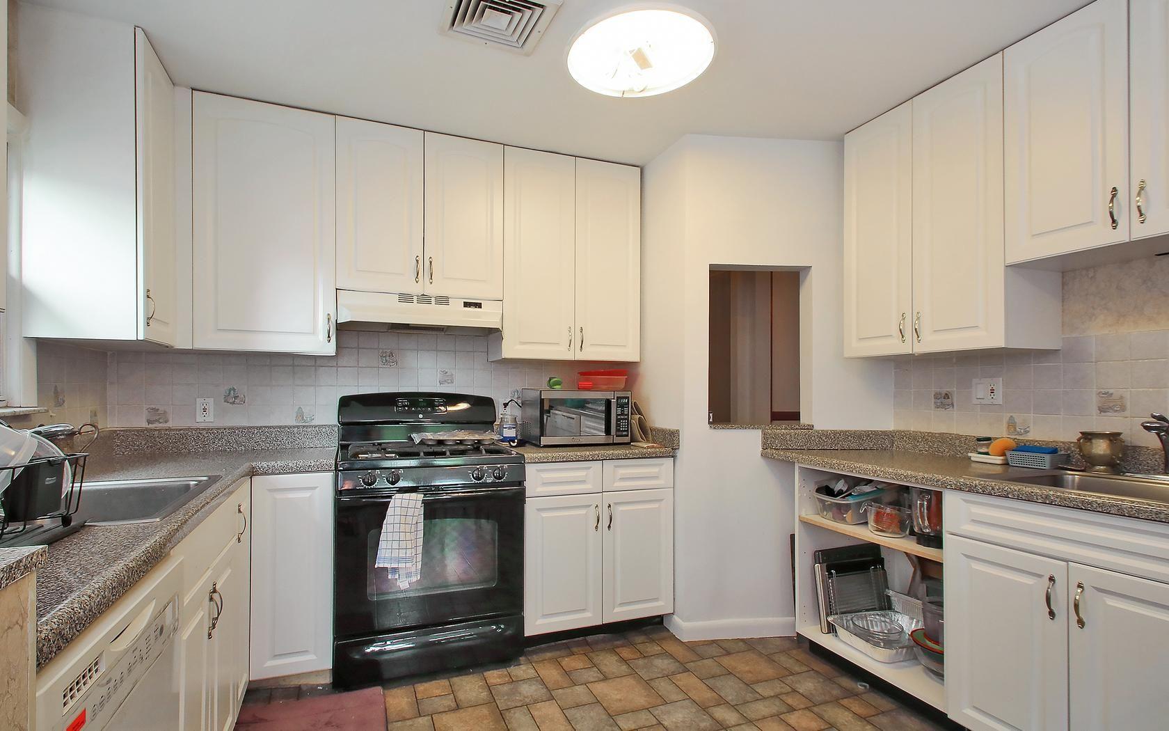 Master bedroom kitchenette  kitchen cooking appliances stove cabinets   Sunrise Ter