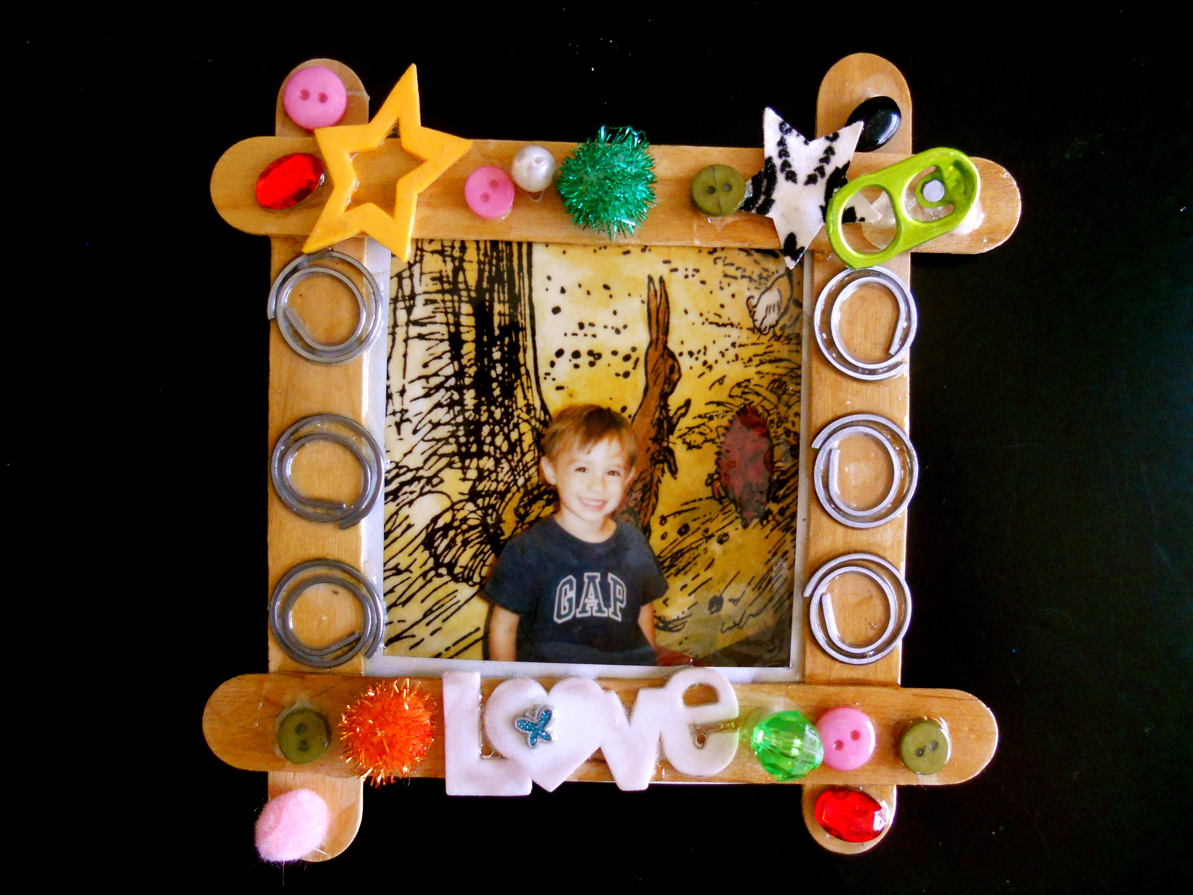 easy craft with children...decorated tongue depressor picture frames ...
