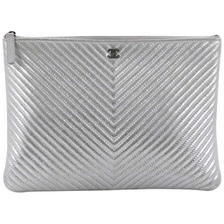 2e7e76ace49f Chanel O Case Clutch Chevron Lambskin Medium