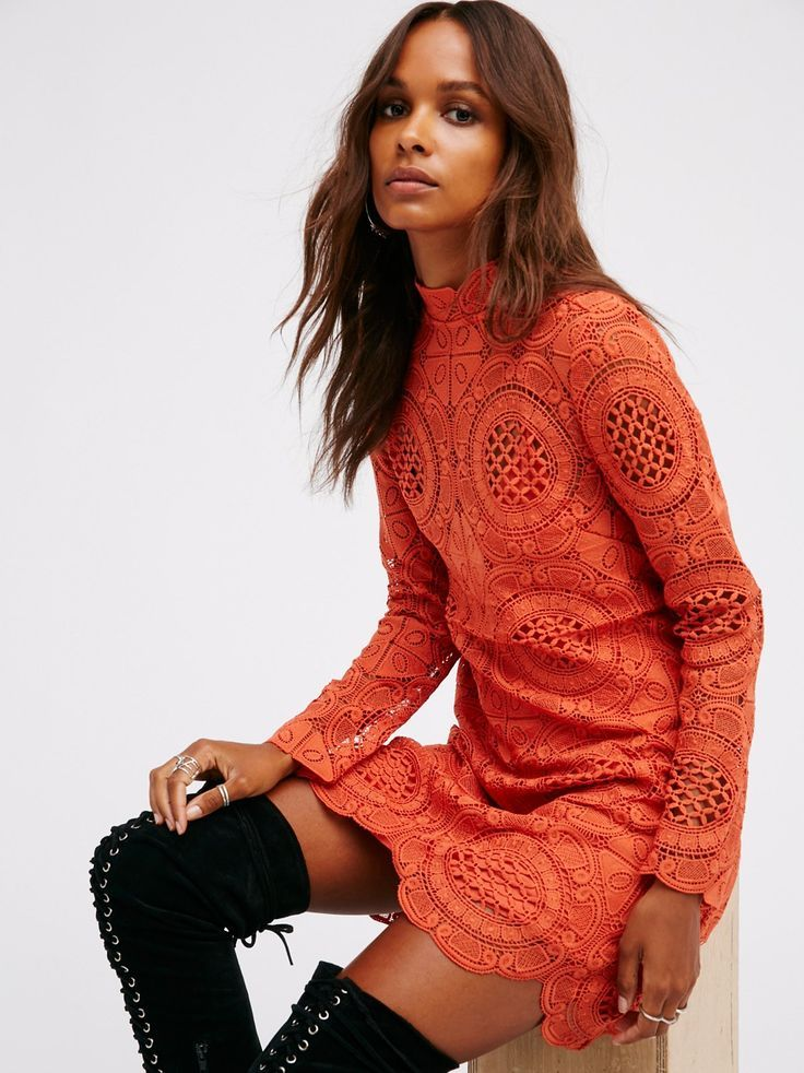 Crochet lace mini dress featuring a mock neck, long sleeves and scalloped  edges. Keyhole