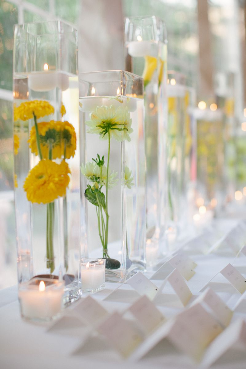 Place Card Table With Yellow Flowers and Tall Glass Vases | Place ...