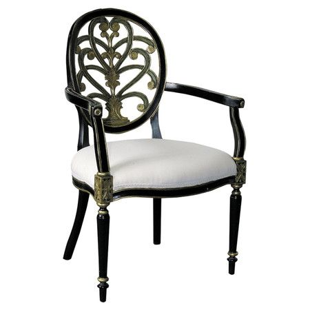 Featuring a stylized anthemion on its back, this hand-painted arm chair is made from mahogany and boasts a raw silk-upholstered seat cushion.