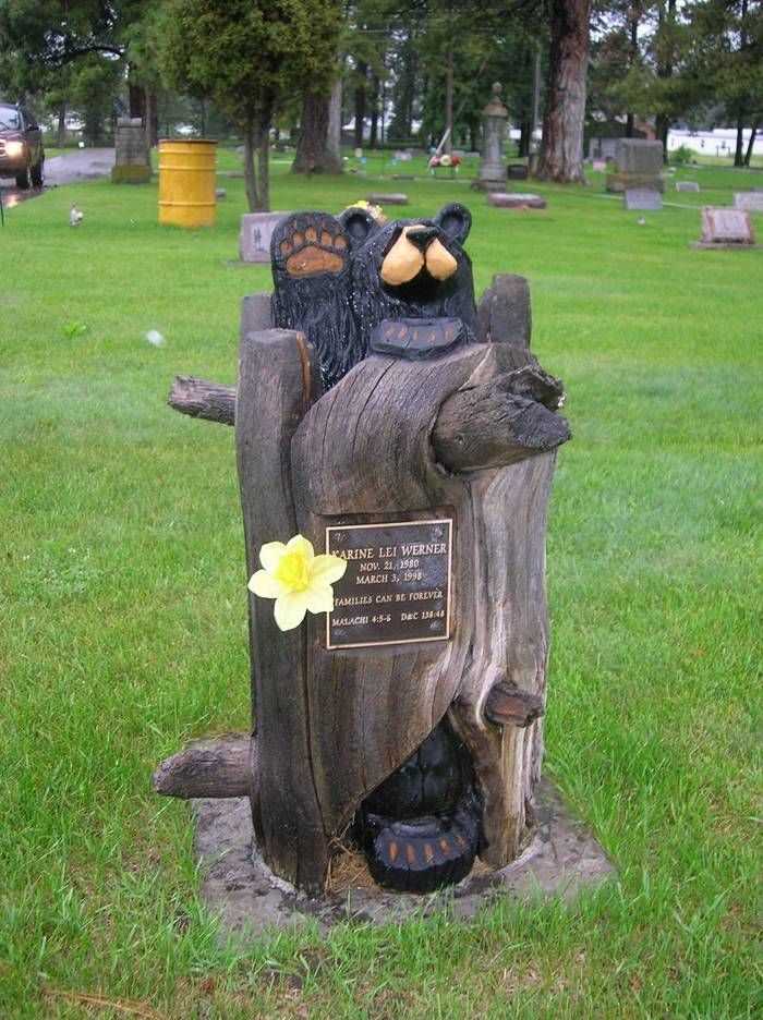 Wood carved memorial seems fitting to be found in the