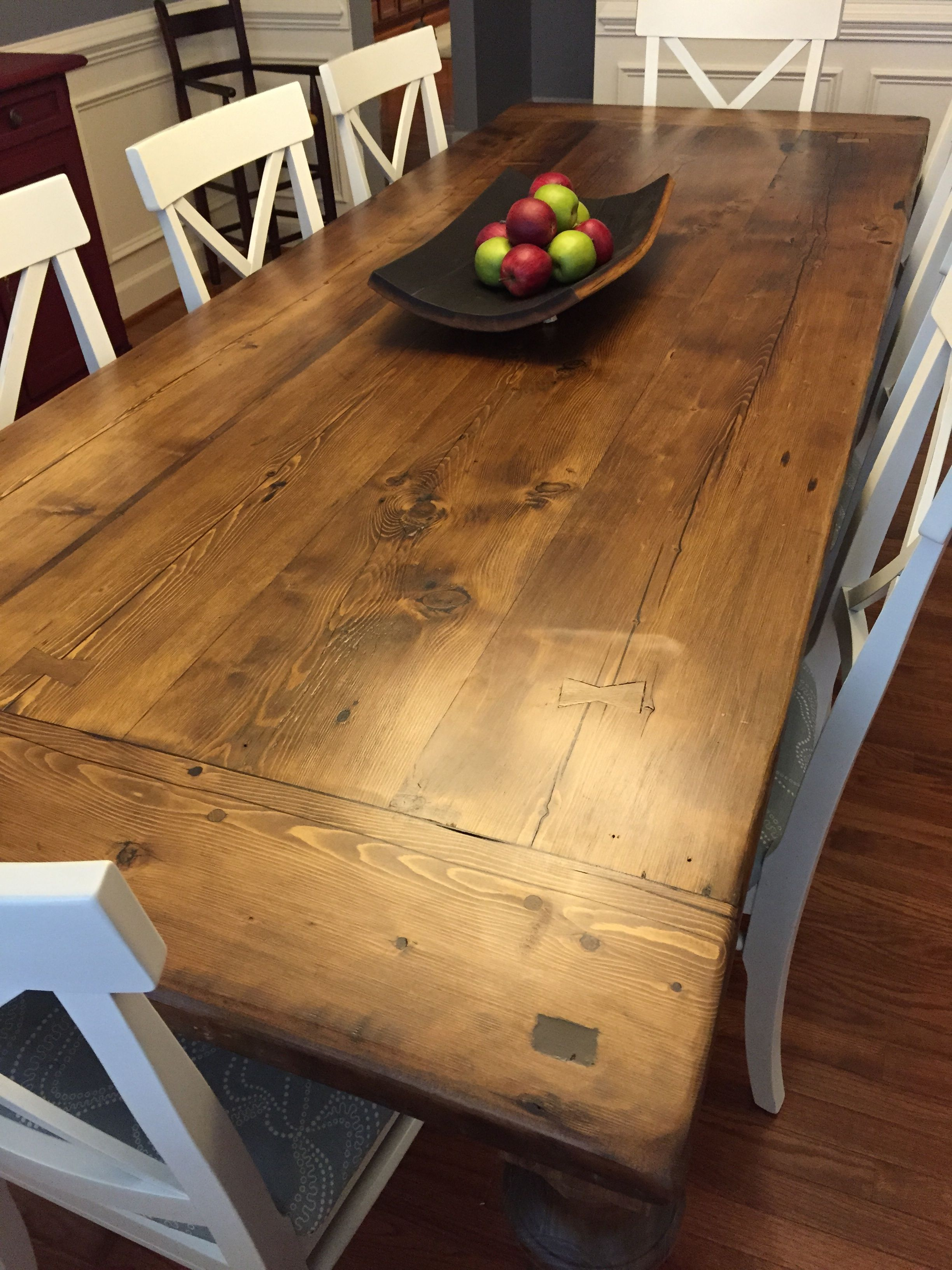 Reclaimed wood dining table with a 2 thick plank top breadboards and custom turned legs handcrafted by concepts created in va