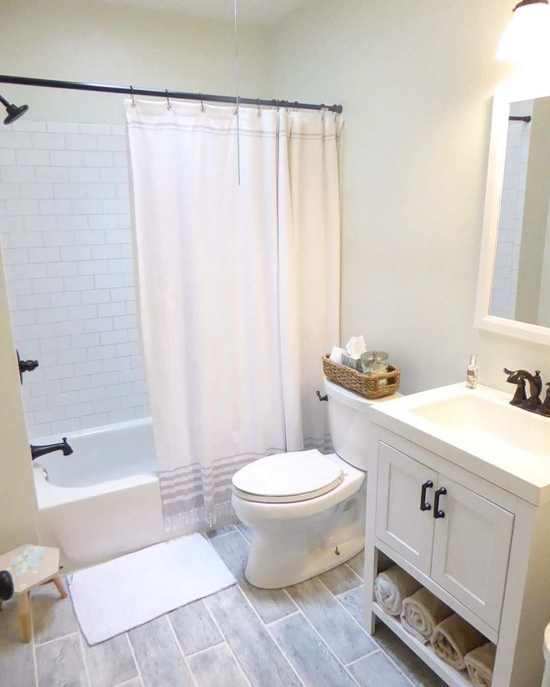 Small bathroom remodel. Clean and bright, grey floors, white subway ...