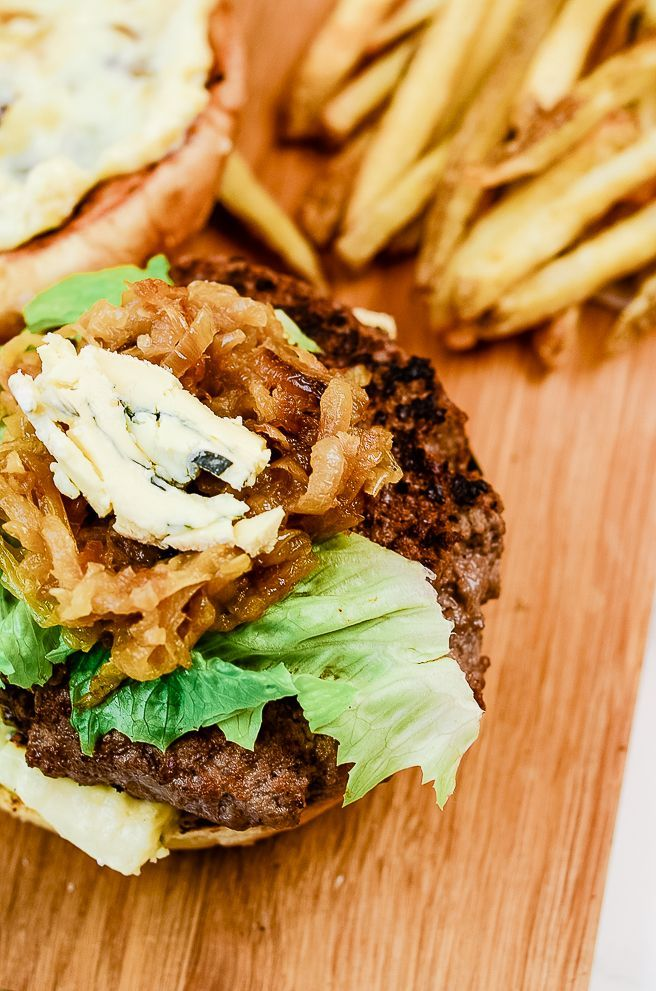 Roasted Garlic Burger with Cambozola This roasted garlic cambozola burger may seem unassuming but this creamy gourmet cheeseburger boasts a sweet and tangy flavor perfect for your next cookout!