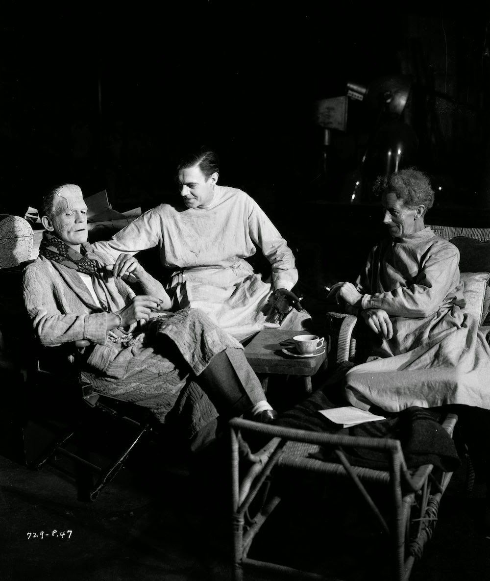 circa 1935:  From left to right, actors Boris Karloff, Colin Clive and Ernest Thesiger pause for a cigarette break on the set of 'Bride of Frankenstein', directed by James Whale. They are still in costume as two mad scientists and a monster.  (Photo via John Kobal Foundation/Getty Images)