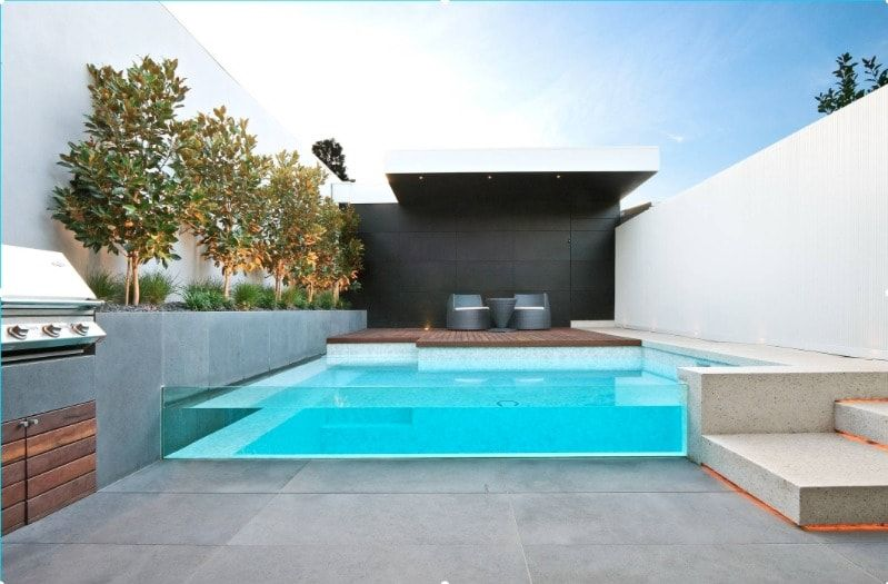 Elevated Swimming Pool With Glass Walls – Interior Design Ideas
