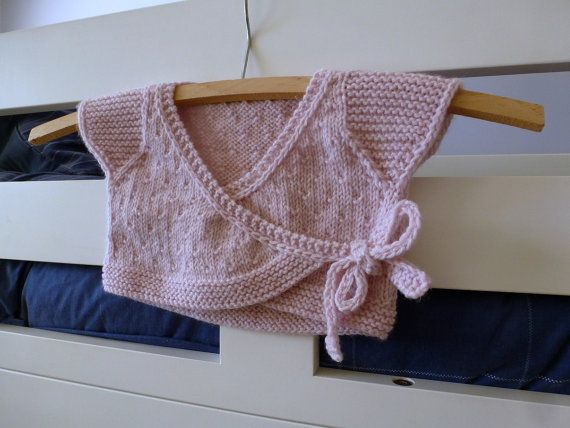Handknitted by me in a non smoking household, this baby wrap cardigan has a sweet all-over pattern stitch, curved edges, cute capped sleeves, and