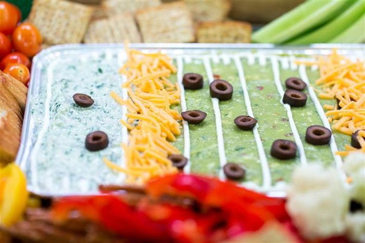 Section off dips in a serving tray to make an edible football stadium.