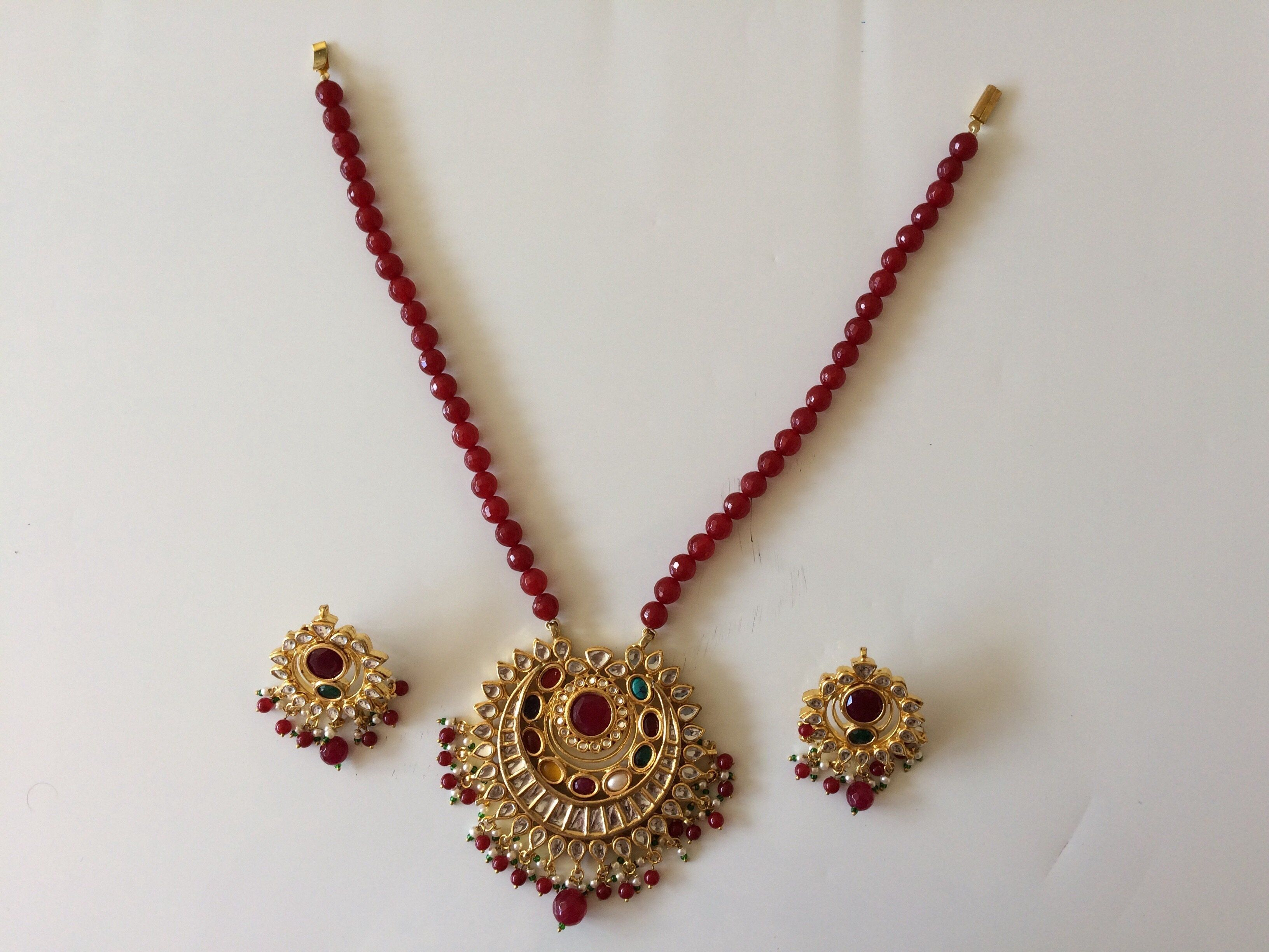 Red kundan pendant set with earrings pendant set and products