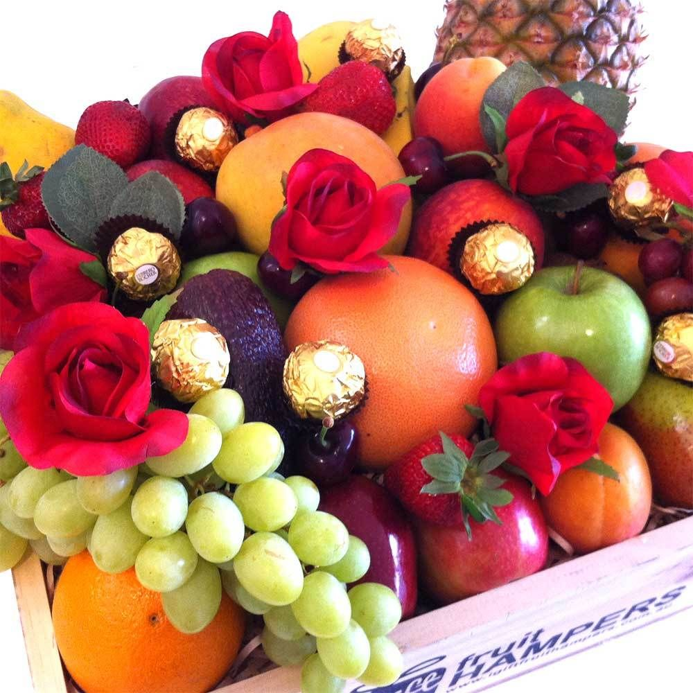 Fruit Hamper With Silk Red Roses And Ferrero Chocolates Fruit Hampers Gift Hampers Fruit In Season