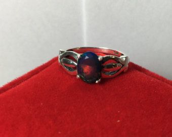 Fascinating color changing effect black Opal silver ring made