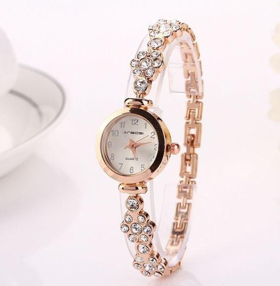 Dámské hodinky náramkové ve zlaté barvě ze zirkonů Na tento produkt se  vztahuje nejen zajímavá sleva 207ec4e3a4