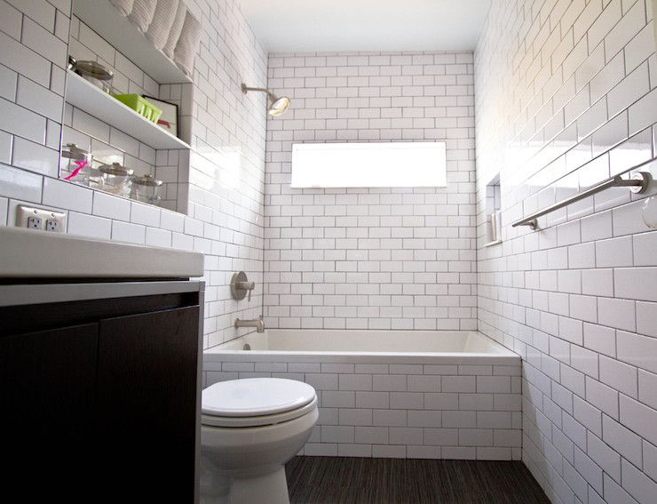 contemporary bathroom with subway tiled drop-in tub with subway