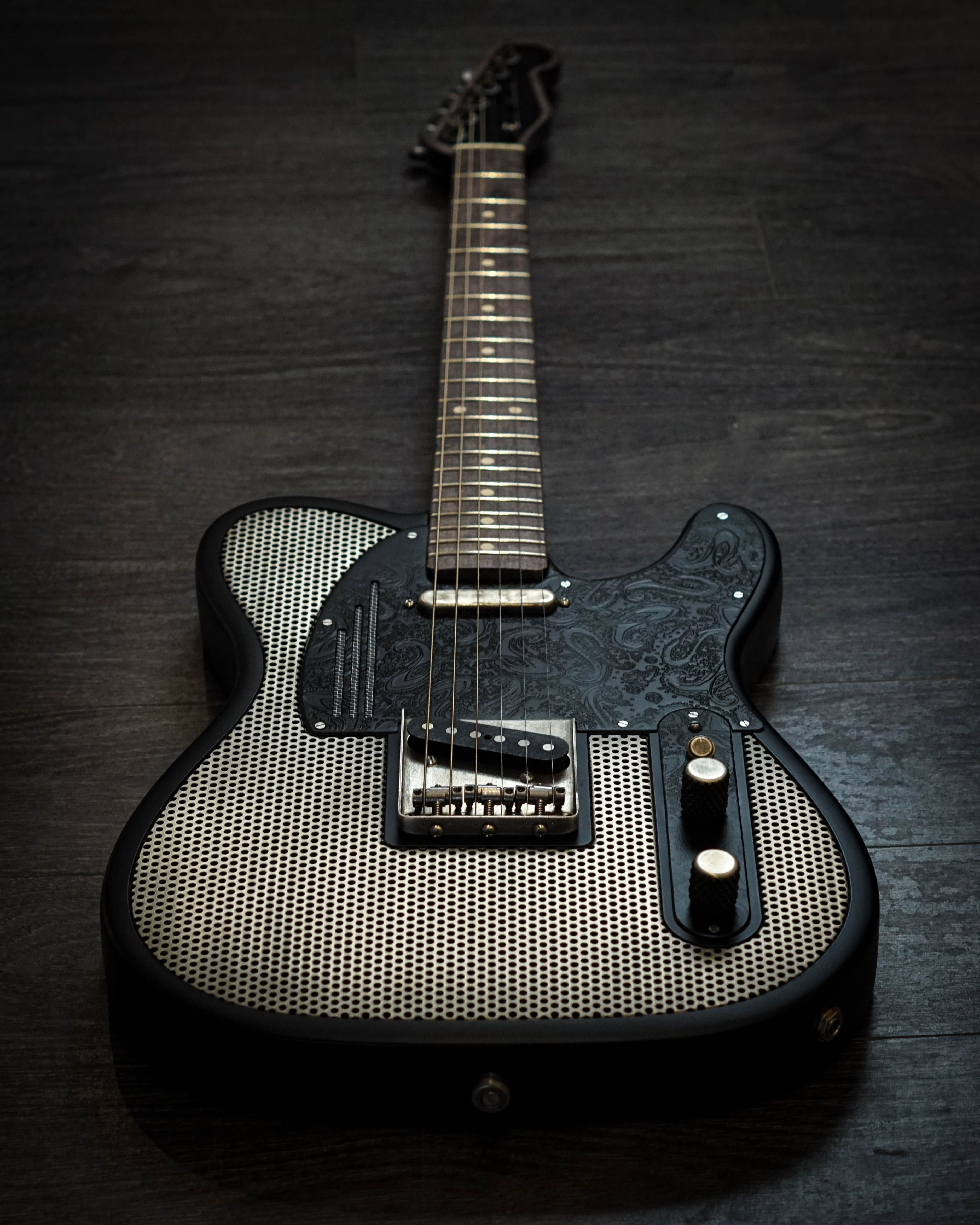 James Trussart Holey Steelcaster in Silver & Black. Available at distinctiveguitar.com. #customguitars