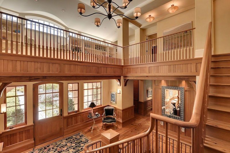 Craftsman Staircase with High ceiling Hardwood floors Balcony