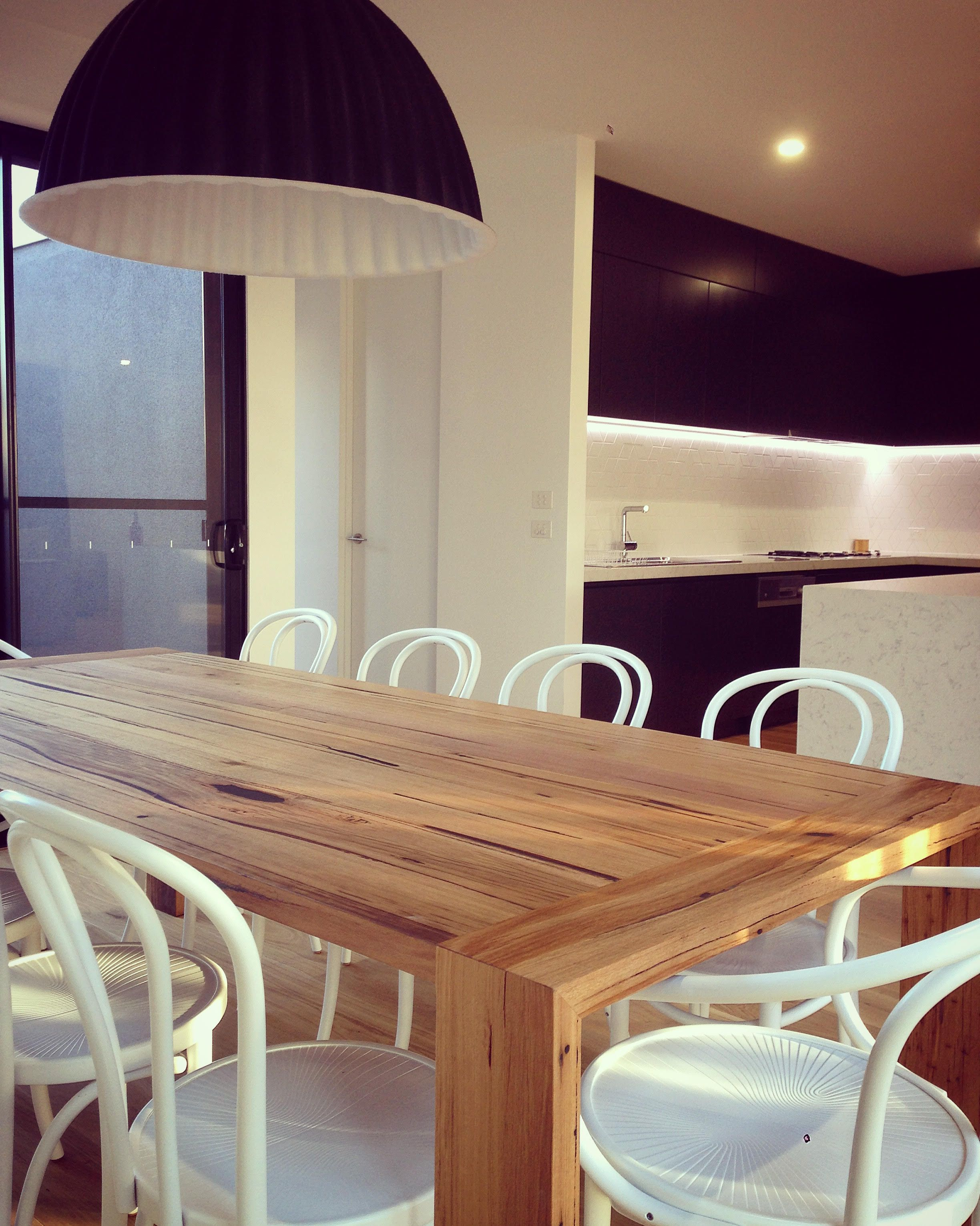 Custom dining table with waterfall breadboard ends made by Bombora