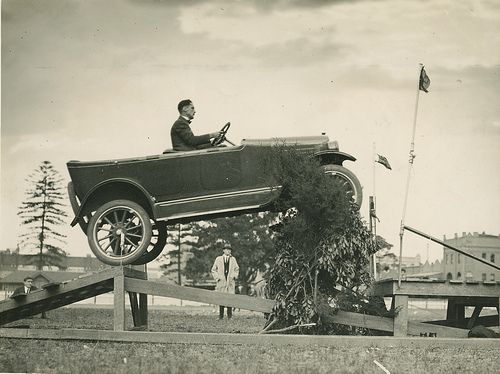 "Overland car jumping a ""fallen bridge"" in a promotional stunt, 1920 - 1929"