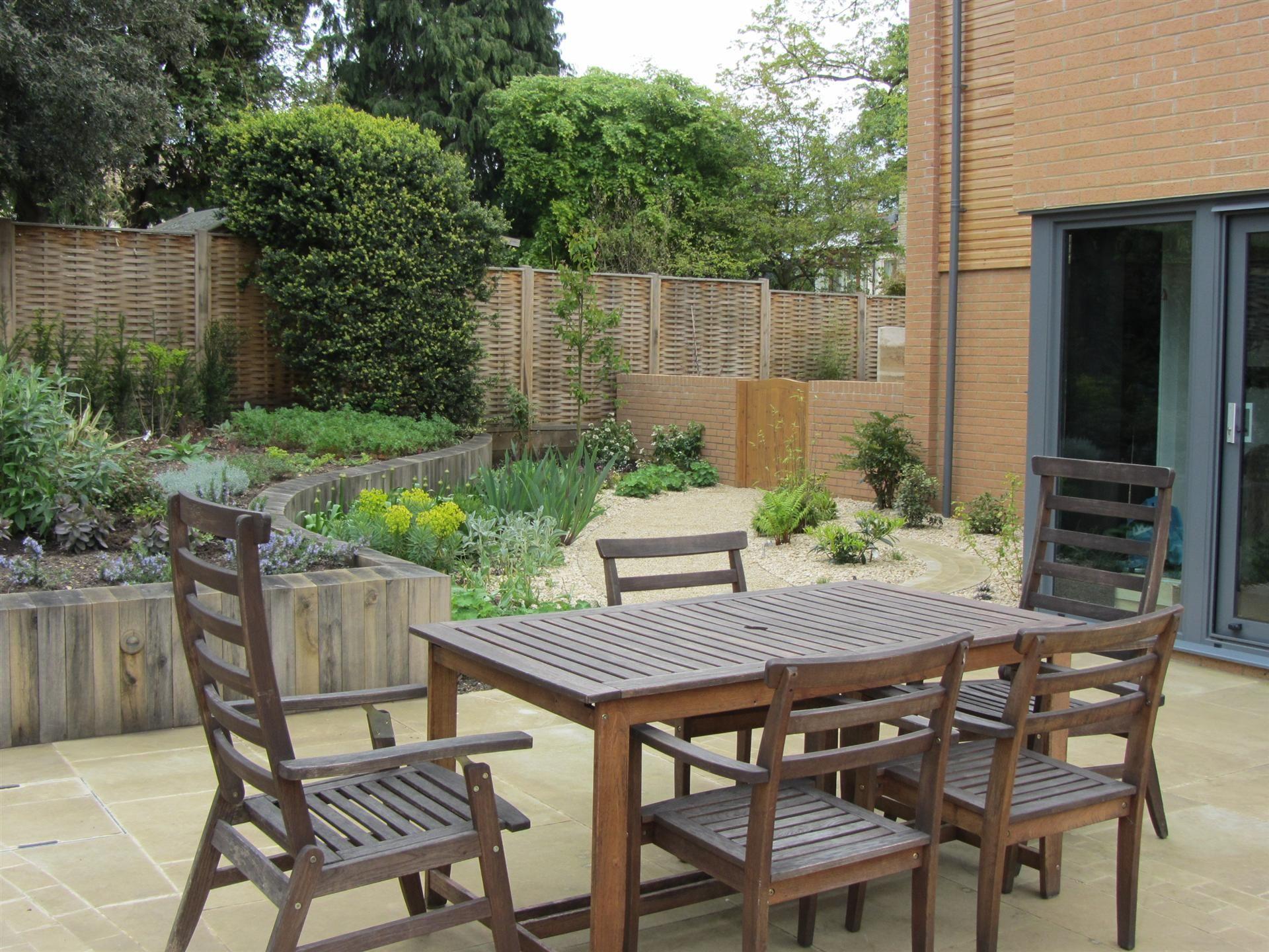 Sawn yorkstone terrace in contemporary garden by Rose Lennard