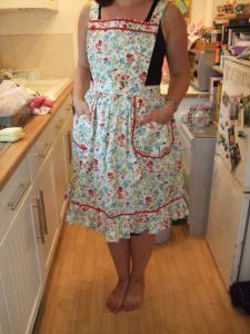 A new sewing adventure to bore you all with: I borrowed a vintage apron pattern from Lemonianta and used it to make her an apron as part of her birthday present.  It turned out well, and here it is…