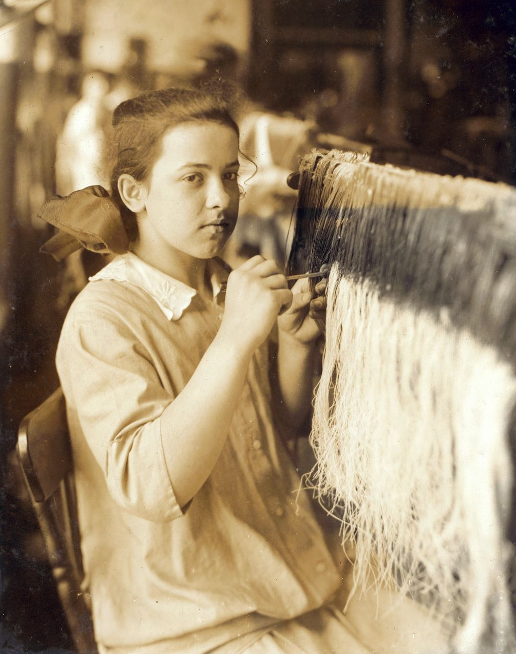 A mill girl working - around 1912