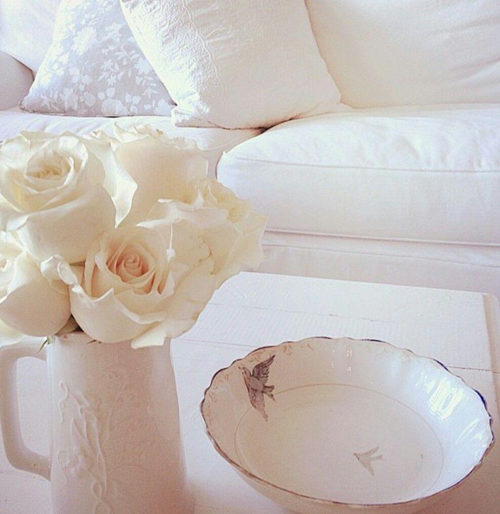 Shabby Chic Decor & Inspiration with white sofa, white pitcher, and white roses. #allwhitedecor #shabbychic #rachelashwell