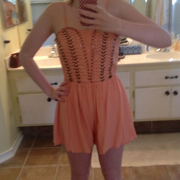 Peach Embellished Romper Cute peach romper. Worn once. In third pic you can barely see the minuscule pink stain. I don't know where that was from but you can't see unless you look really hard for it. Also includes the spaghetti straps that connect to romper Tobi Other