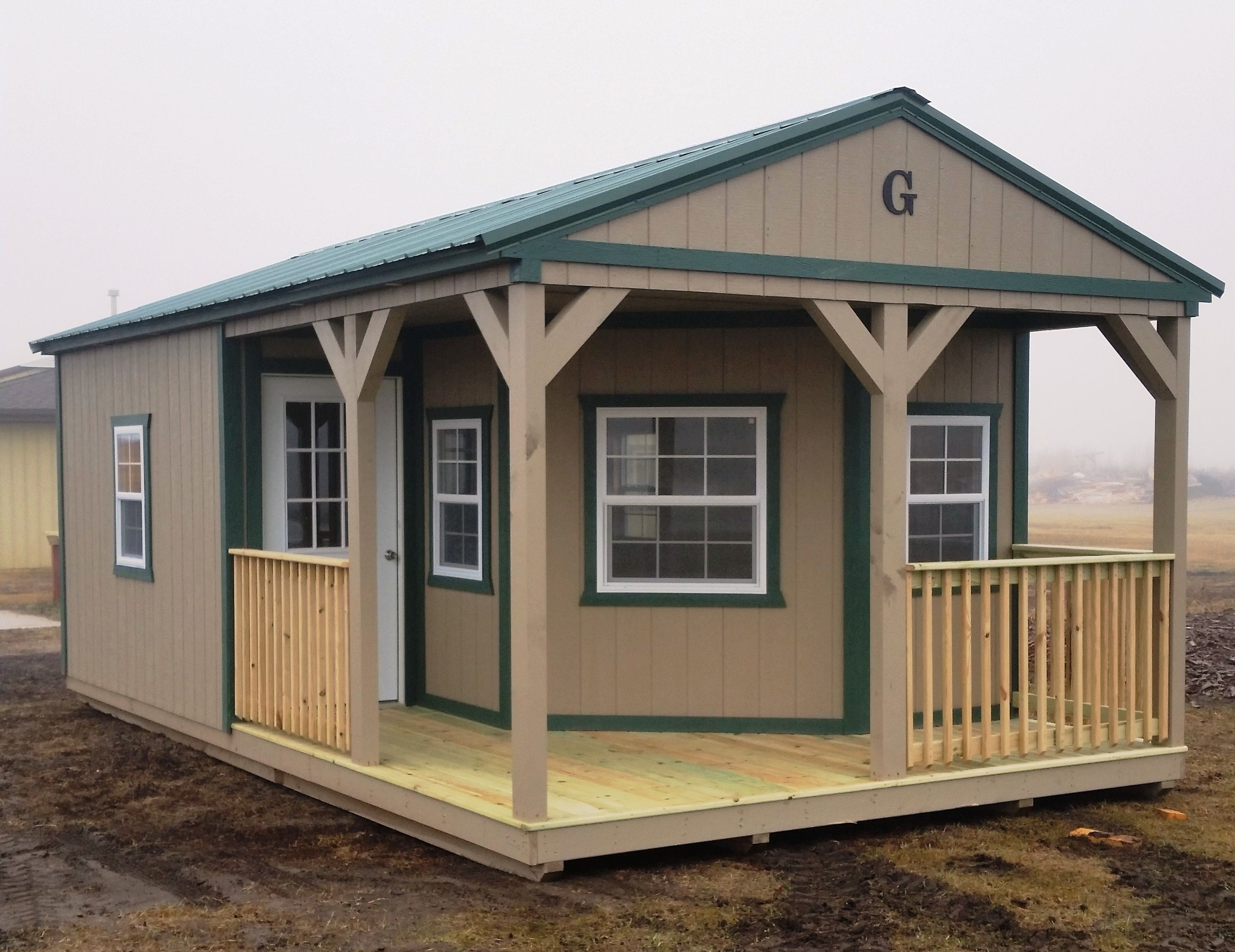 14x24 Cabin With L Shaped Porch And Railings Green Metal Roof With Matching Trim Lp Smartside Painted San Portable Buildings Metal Buildings Portable Sheds
