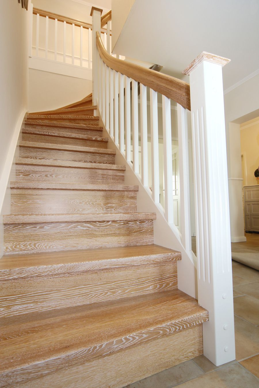 Photo of Cheek staircase ensures a harmonious room ambience!