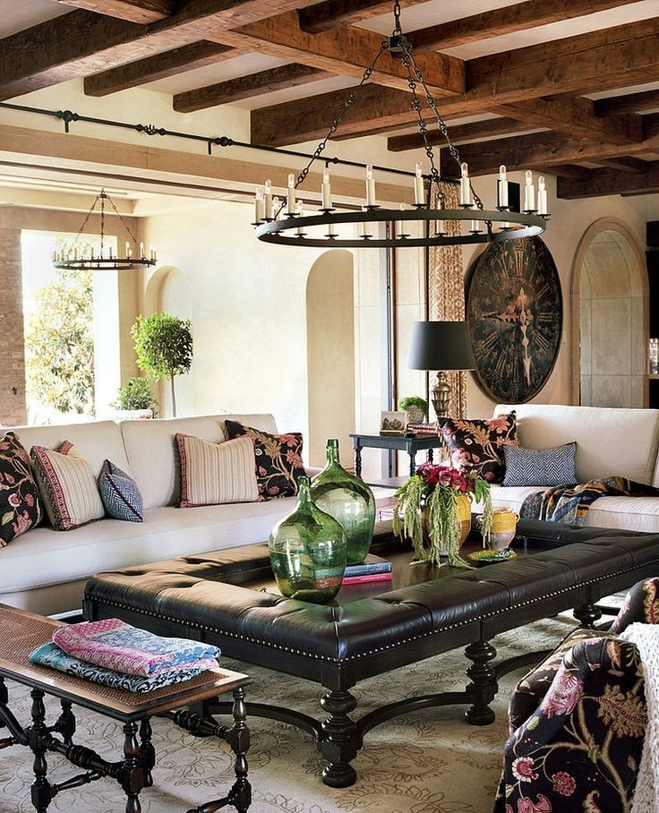 Spanish Style Living Room Furniture Vinyl Flooring Ideas For Any Of Decor House Rod Iron Light Fixture Neutral Anf Natural Area Rug Neurtral Colorful Pillows And Wall Art Plants