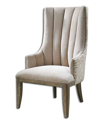 Zyla Armchair - An exquisite composition in a neutral colorway of almond champagne, the Zyla Armchair takes on a trim, traditional look from its tall channel-tufted back, but the striking animal print in the chenille upholstery of its outer form hints at more playful tastes, retaining elegant serenity as well as updated energy. Nailhead trim and lengthy wood legs complete the appearance.