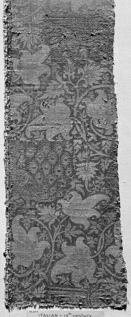 Dull light violet satin ground. The design of scrolling stems bearing large and small leaves, griffins and peacocks, is woven with flesh color and yellow silk and gilded gold beater'sskin.