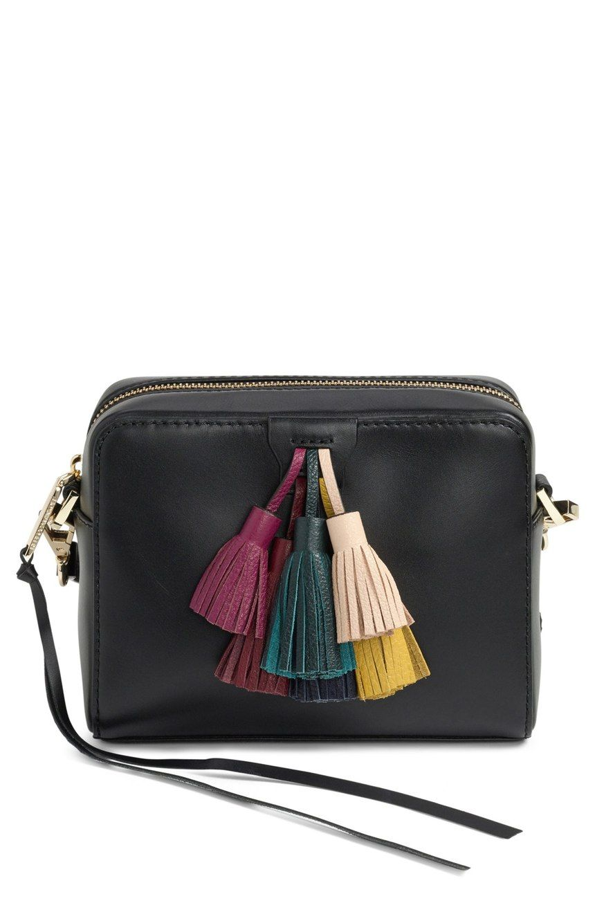 Colorful leather tassels brighten and liven up this minimalist crossbody bag…