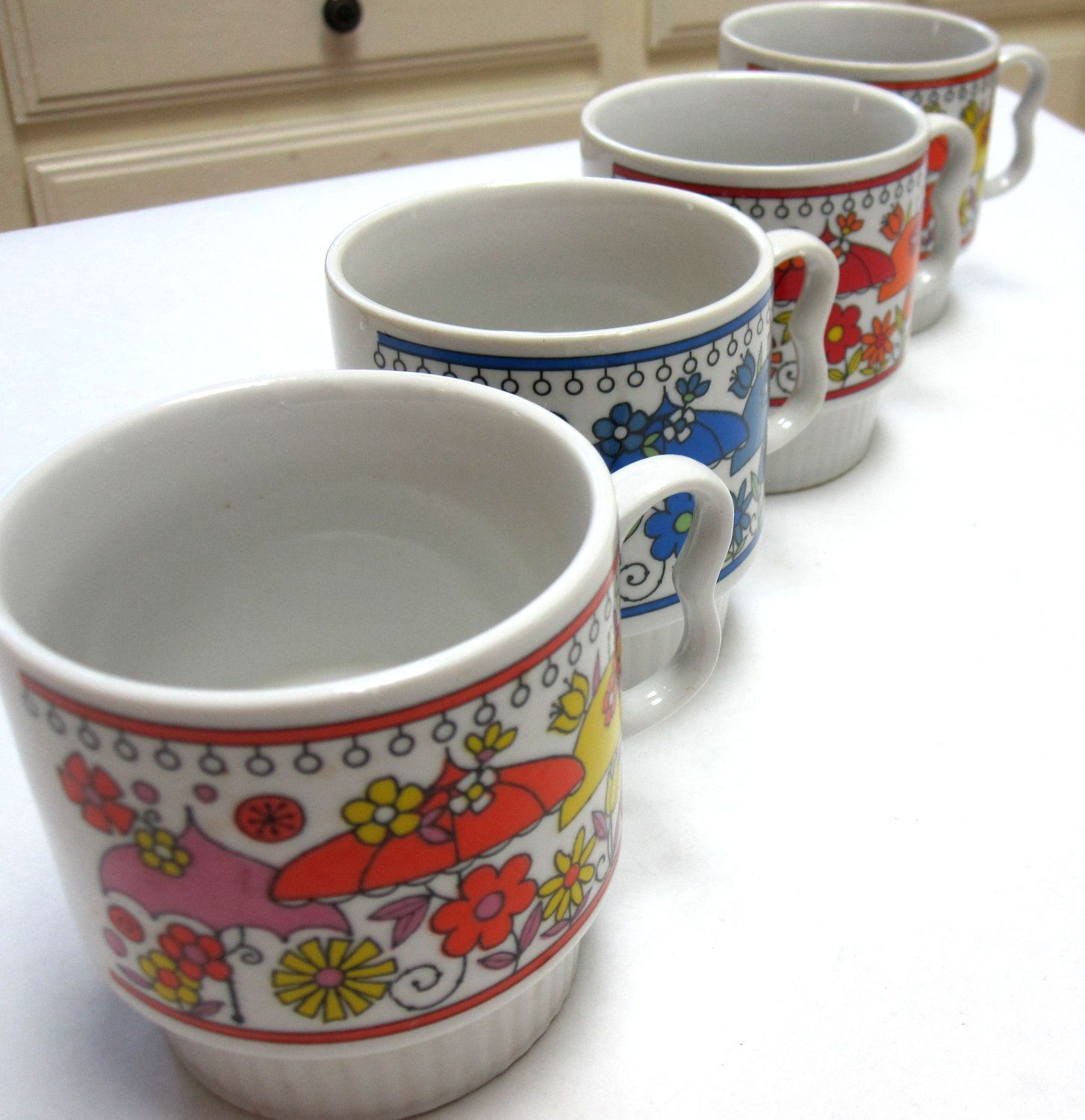 Set of Four White & Multi Colored Floral Ceramic Mugs