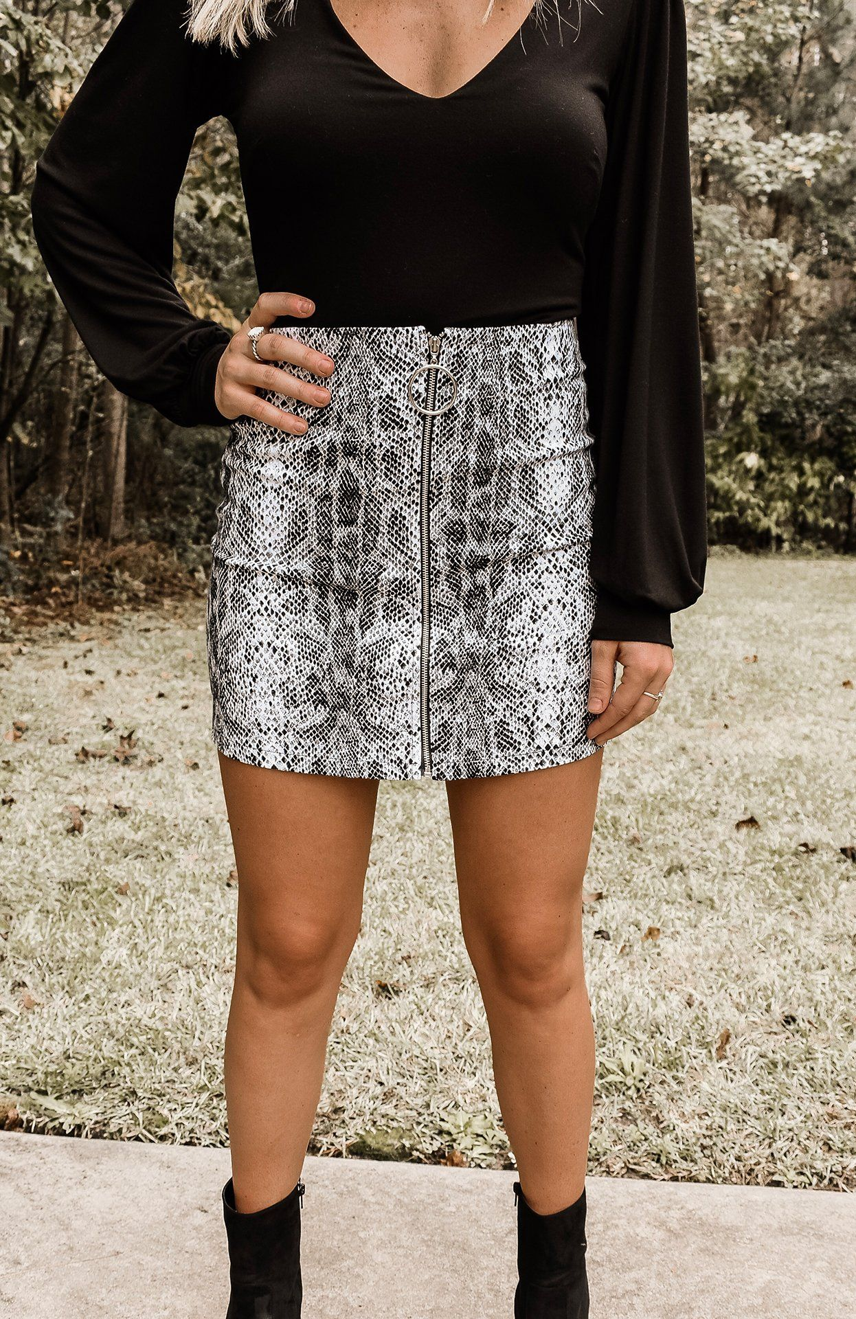 782d58dda2 Black & white snakeskin printed mini skirt with an O ring zipper closure  front. Kennedy is 5'3, a size 2 & wearing a small Fits true to size - if  between ...