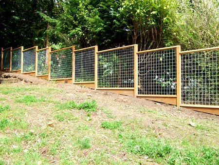 hog wire fence designs for slopped yard - Google Search